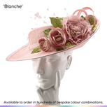 Blanche.  Tipped perching hat with dramatic sculpted upturned brim.  Trimmed with spray of handmade silk Peony flowers and trimmed with spray of trimmed feathers.  Available to order in thousands of colour combinations to match your outfit perfectly.  Handmade by Marvellous Millinery, Winchester, Hampshire UK.  Bespoke wedding hats for Mother of the Bride, Mother of the Groom, Top Table Wedding Guests, Ladies Day at Royal Ascot, Glorious Goodwood, Garden Parties at Buckingham Palace and Royal Investitures.