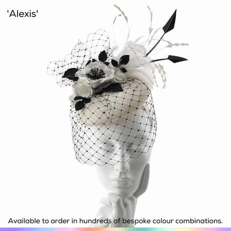 Alexis.  A very dramatic perching pillbox hat, featuing a layer of crystal-set birdcage veiling, a spray of silk roses, a plume of bobbing feathers and a pair of arrowhead quills.  Available to order in thousands of colour combinations to match your outfit perfectly.  Handmade by Marvellous Millinery, Winchester, Hampshire UK.  Bespoke ladies wedding hats for Mother of the Bride, Mother of the Groom, Top Table Wedding Guests, Ladies Day at Royal Ascot, Glorious Goodwood, Garden Parties at Buckingham Palace and Royal Investitures.