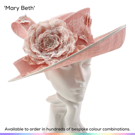 Mary Beth.  A classic ladies picture hat, featuring a gutter crown and sweeping upturned brim.  A large rose made from silk and lace decorates the hat, which is highlighted with a hatband of the same lace and supprted by a stylish slanted bow.  Tiny silk and lace butterflies accent the design.  Available to order in thousands of colour combinations to match your outfit perfectly.  Handmade by Marvellous Millinery, Winchester, Hampshire UK.  Bespoke ladies wedding hats for Mother of the Bride, Mother of the Groom, Top Table Wedding Guests, Ladies Day at Royal Ascot, Glorious Goodwood, Garden Parties at Buckingham Palace and Royal Investitures.