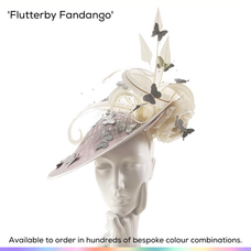 Flutterby Fandango.  A very dramtic saucer slice headpiece featuring a beautiful pair of silk English roses, numerous trimmed and curled ostrich feathers, sprays of crystal-set birdcage veiling, sinamay spirals and adorned with a harlequin of silk butterflies.  Available to order in thousands of colour combinations to match your outfit perfectly.  Handmade by Marvellous Millinery, Winchester, Hampshire UK.  Bespoke ladies wedding hats for Mother of the Bride, Mother of the Groom, Top Table Wedding Guests, Ladies Day at Royal Ascot, Glorious Goodwood, Garden Parties at Buckingham Palace and Royal Investitures.