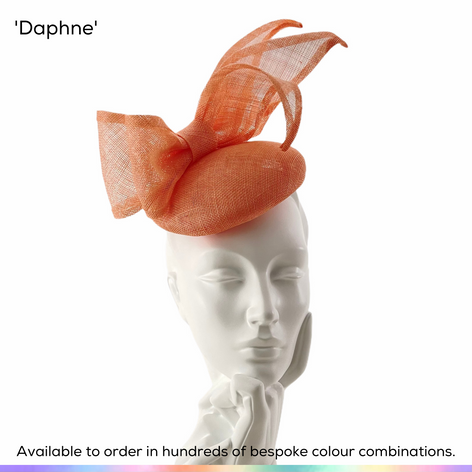 Daphne.  An uncluttered double bow sits dramatically above a simple button shaped perching pillbox hat.  Available to order in thousands of colour combinations to match your outfit perfectly.  Handmade by Marvellous Millinery, Winchester, Hampshire UK.  Bespoke ladies wedding hats for Mother of the Bride, Mother of the Groom, Top Table Wedding Guests, Ladies Day at Royal Ascot, Glorious Goodwood, Garden Parties at Buckingham Palace and Royal Investitures.