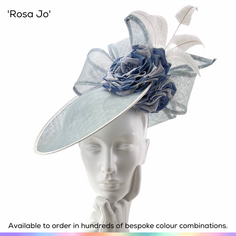 Rosa Jo.  Pretty saucer slice shaped ladies hat featuring handmade silk roses and oversized double bow.  Finished with fan of curled ostrich feathers.  Available to order in thousands of colour combinations to match your outfit perfectly.  Handmade by Marvellous Millinery, Winchester, Hampshire UK.  Bespoke ladies wedding hats for Mother of the Bride, Mother of the Groom, Top Table Wedding Guests, Ladies Day at Royal Ascot, Glorious Goodwood, Garden Parties at Buckingham Palace and Royal Investitures.