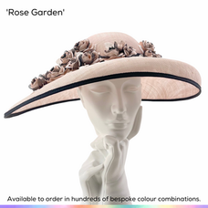 Rose Garden.  A stylish downturned 'Easte West' brimmed hat with a vintage look, adorned with a scattering of delicate handmade silk rambling roses.   Available to order in thousands of colour combinations to match your outfit perfectly.  Handmade by Marvellous Millinery, Winchester, Hampshire UK.  Bespoke ladies wedding hats for Mother of the Bride, Mother of the Groom, Top Table Wedding Guests, Ladies Day at Royal Ascot, Glorious Goodwood, Garden Parties at Buckingham Palace and Royal Investitures.