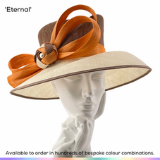 Eternal.  Classic formal ladies picture hat featuring angular lines and a dramatic double bow.  Available to order in thousands of colour combinations to match your outfit perfectly.  Handmade by Marvellous Millinery, Winchester, Hampshire UK.  Bespoke ladies wedding hats for Mother of the Bride, Mother of the Groom, Top Table Wedding Guests, Ladies Day at Royal Ascot, Glorious Goodwood, Garden Parties at Buckingham Palace and Royal Investitures.