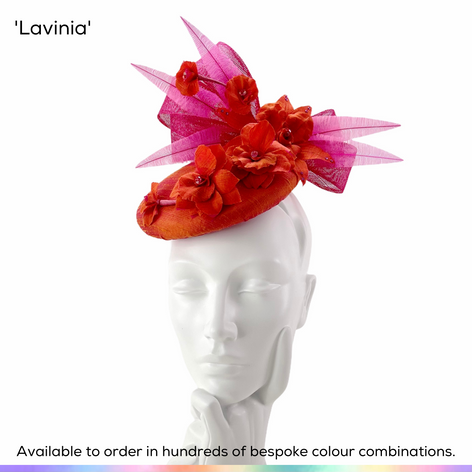Lavinia.  Perching pillbox button beret shaped hat featuing silk covered base, handmade silk flowers, crystals, hand-tied bow and trimmed ostrich feathers.  Available to order in thousands of colour combinations to match your outfit perfectly.  Handmade by Marvellous Millinery, Winchester, Hampshire UK.  Bespoke wedding hats for Mother of the Bride, Mother of the Groom, Top Table Wedding Guests, Ladies Day at Royal Ascot, Glorious Goodwood, Garden Parties at Buckingham Palace and Royal Investitures.
