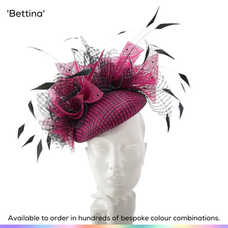 Bettina.  Perching beret pillbox style ladies hat featuring layer of windowpane sinamay and dramatic abstract gathers of sinamay sprays.  Trimmed with bobbing diamond-shaped feathers and dotted with crystals.  Available to order in thousands of colour combinations to match your outfit perfectly.  Handmade by Marvellous Millinery, Winchester, Hampshire UK.  Bespoke ladies wedding hats for Mother of the Bride, Mother of the Groom, Top Table Wedding Guests, Ladies Day at Royal Ascot, Glorious Goodwood, Garden Parties at Buckingham Palace and Royal Investitures.