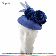 Sophia.  Charming larger button pillbox design, trimmed with a classic spray of english Tea roses in silk and finished with a spray of shaped ostrich feathers.  Available to order in thousands of colour combinations to match your outfit perfectly.  Handmade by Marvellous Millinery, Winchester, Hampshire UK.  Bespoke ladies wedding hats for Mother of the Bride, Mother of the Groom, Top Table Wedding Guests, Ladies Day at Royal Ascot, Glorious Goodwood, Garden Parties at Buckingham Palace and Royal Investitures.