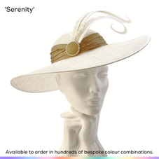 Serenity.  A classic style of elegant simplicity. The wide sweeping brim gently curves around the dome crown and frames the face beautifully.  Trimmed with a drape of silk, a pearl-trimmed button and a delightful pair of gently curled feathers.  Available to order in thousands of colour combinations to match your outfit perfectly.  Handmade by Marvellous Millinery, Winchester, Hampshire UK.  Bespoke ladies wedding hats for Mother of the Bride, Mother of the Groom, Top Table Wedding Guests, Ladies Day at Royal Ascot, Glorious Goodwood, Garden Parties at Buckingham Palace and Royal Investitures.
