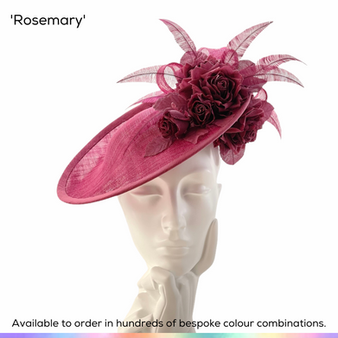 Rosemary.  Pretty saucer slice shaped ladies hat featuring handmade silk/cotton roses and delicate trible bow.  Finished with a scattering of curled ostrich feathers.  Available to order in thousands of colour combinations to match your outfit perfectly.  Handmade by Marvellous Millinery, Winchester, Hampshire UK.  Bespoke ladies wedding hats for Mother of the Bride, Mother of the Groom, Top Table Wedding Guests, Ladies Day at Royal Ascot, Glorious Goodwood, Garden Parties at Buckingham Palace and Royal Investitures.
