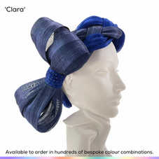 Clara.  Unusual vintage style plaited headband halo headpiece made from Silk Abaca and featuring a massive oversized bow which can be worn to one side or directly behind.  The centre cynch of the bow has been decorat4ed with handset crystals.  Available to order in thousands of colour combinations to match your outfit perfectly.  Handmade by Marvellous Millinery, Winchester, Hampshire UK.  Bespoke ladies wedding hats for Mother of the Bride, Mother of the Groom, Top Table Wedding Guests, Ladies Day at Royal Ascot, Glorious Goodwood, Garden Parties at Buckingham Palace and Royal Investitures.