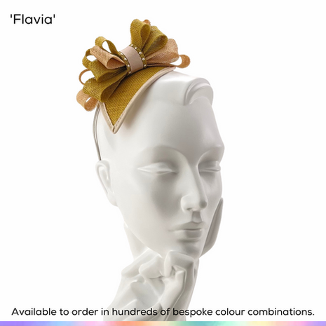 Flavia.  Uncomplicated fascinator on headband, featuring a teardrop shaped base and multi-layerd bow in a mixture of colours.  Available to order in thousands of colour combinations to match your outfit perfectly.  Handmade by Marvellous Millinery, Winchester, Hampshire UK.  Bespoke ladies wedding hats for Mother of the Bride, Mother of the Groom, Top Table Wedding Guests, Ladies Day at Royal Ascot, Glorious Goodwood, Garden Parties at Buckingham Palace and Royal Investitures.