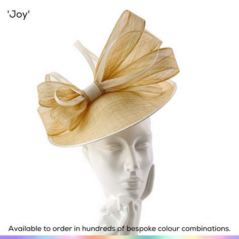 Joy.  A dramatic multi-layered bow sits proudly upon a very flattering saucer disc hat.  Available to order in thousands of colour combinations to match your outfit perfectly.  Handmade by Marvellous Millinery, Winchester, Hampshire UK.  Bespoke ladies wedding hats for Mother of the Bride, Mother of the Groom, Top Table Wedding Guests, Ladies Day at Royal Ascot, Glorious Goodwood, Garden Parties at Buckingham Palace and Royal Investitures.