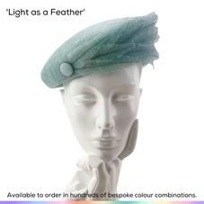 Light as a Feather.  An understated elegant beret style pillbox ladies hat featuring a descrete flurry of soft trimmed ostrich feathers.  Available to order in thousands of colour combinations to match your outfit perfectly.  Handmade by Marvellous Millinery, Winchester, Hampshire UK.  Bespoke ladies wedding hats for Mother of the Bride, Mother of the Groom, Top Table Wedding Guests, Ladies Day at Royal Ascot, Glorious Goodwood, Garden Parties at Buckingham Palace and Royal Investitures.