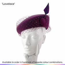 Lovelace.  A stylish minimalist ladies hat, featuring a sculpted beret style base that has been wrapped in a swathe of birdcage veiling set with a scattering of crystals.  A silk covered button rests over one eye and the design is topped off with an arrowhead quill.  Available to order in thousands of colour combinations to match your outfit perfectly.  Handmade by Marvellous Millinery, Winchester, Hampshire UK.  Bespoke ladies wedding hats for Mother of the Bride, Mother of the Groom, Top Table Wedding Guests, Ladies Day at Royal Ascot, Glorious Goodwood, Garden Parties at Buckingham Palace and Royal Investitures.