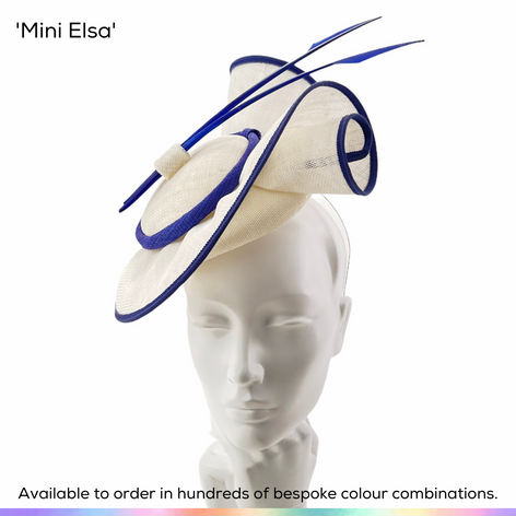 Mini Elsa.  Sister to the larger Elsa style, this pillbox hat perches over one eye and features a dramatic double scroll and pair of stripped quills.  Available to order in thousands of colour combinations to match your outfit perfectly.  Handmade by Marvellous Millinery, Winchester, Hampshire UK.  Bespoke ladies wedding hats for Mother of the Bride, Mother of the Groom, Top Table Wedding Guests, Ladies Day at Royal Ascot, Glorious Goodwood, Garden Parties at Buckingham Palace and Royal Investitures.