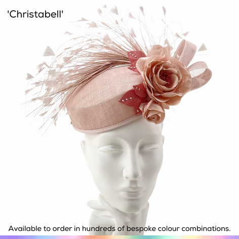 Christabell.  Charming perching pillbox hat, trimmed with a posy of handmade silk roses and trimmed with a double bow and fan of bobbing shaped feathers.  Available to order in thousands of colour combinations to match your outfit perfectly.  Handmade by Marvellous Millinery, Winchester, Hampshire UK.  Bespoke ladies wedding hats for Mother of the Bride, Mother of the Groom, Top Table Wedding Guests, Ladies Day at Royal Ascot, Glorious Goodwood, Garden Parties at Buckingham Palace and Royal Investitures.