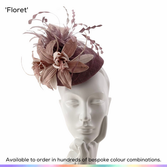Floret.  A shaped perching pillbox hat, featuring a beautiful pair of orching flowers that have been framed by a gorgeous hand-tied sinamay bow and framed with a spray of gently bobbing feathers.  Available to order in thousands of colour combinations to match your outfit perfectly.  Handmade by Marvellous Millinery, Winchester, Hampshire UK.  Bespoke ladies wedding hats for Mother of the Bride, Mother of the Groom, Top Table Wedding Guests, Ladies Day at Royal Ascot, Glorious Goodwood, Garden Parties at Buckingham Palace and Royal Investitures.