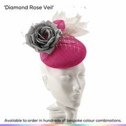 Diamond Rose Veil.  A new classic with a little added texture, featuing a very comfortable petite button pillbox base, trimmed with a gorgeous English rose in full bloom, a flurry of graceful feathers to the rear and above and also spriggs of crystal-set birdcage veiling.  Available to order in thousands of colour combinations to match your outfit perfectly.  Handmade by Marvellous Millinery, Winchester, Hampshire UK.  Bespoke ladies wedding hats for Mother of the Bride, Mother of the Groom, Top Table Wedding Guests, Ladies Day at Royal Ascot, Glorious Goodwood, Garden Parties at Buckingham Palace and Royal Investitures.