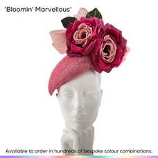 Bloomin' Marvellous.  A stylish peardrop shaped perching pillbox style ladies hat, featuing a generous pair of handmade silk English roses, each using three different complimentary shades of silk. These emormous blooms have been supported by an off-centre layered bow.  Available to order in thousands of colour combinations to match your outfit perfectly.  Handmade by Marvellous Millinery, Winchester, Hampshire UK.  Bespoke ladies wedding hats for Mother of the Bride, Mother of the Groom, Top Table Wedding Guests, Ladies Day at Royal Ascot, Glorious Goodwood, Garden Parties at Buckingham Palace and Royal Investitures.