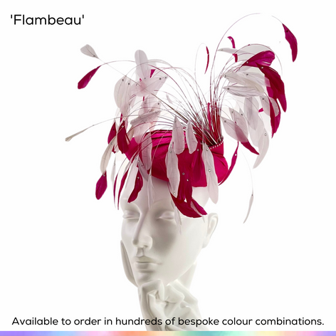 Flambeau.  Dramatic perching pillbox hat, featuring a silk covered base and trimmed with an explosion of bobbing feathers in two complimentary colours, each set with a sparkling crystal.  Available to order in thousands of colour combinations to match your outfit perfectly.  Handmade by Marvellous Millinery, Winchester, Hampshire UK.  Bespoke ladies wedding hats for Mother of the Bride, Mother of the Groom, Top Table Wedding Guests, Ladies Day at Royal Ascot, Glorious Goodwood, Garden Parties at Buckingham Palace and Royal Investitures.