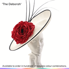 The Deborah.  An oversized saucher/slice style ladies occasionwear hat/headpiece, featuring a sculpural undulating surface, a dramtic large English rose in full bloom which is supported by a delightful doulbe bow to the rear and trimmed with a cluster of long arched quills.  Available to order in thousands of colour combinations to match your outfit perfectly.  Handmade by Marvellous Millinery, Winchester, Hampshire UK.  Bespoke ladies wedding hats for Mother of the Bride, Mother of the Groom, Top Table Wedding Guests, Ladies Day at Royal Ascot, Glorious Goodwood, Garden Parties at Buckingham Palace and Royal Investitures.