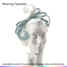 Roaring Twenties.  Curled feather fascinator on headband, featuring a fine off-centre bow graceful curled feathers that cascade over the forhead and down onto the cheek.  Available to order in thousands of colour combinations to match your outfit perfectly.  Handmade by Marvellous Millinery, Winchester, Hampshire UK.  Bespoke ladies wedding hats for Mother of the Bride, Mother of the Groom, Top Table Wedding Guests, Ladies Day at Royal Ascot, Glorious Goodwood, Garden Parties at Buckingham Palace and Royal Investitures.