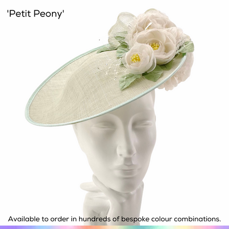 Petite Peony.  A classic flattering saucer slice shaped headpiece, featuring a posy of  handmade silk peony flowers and highlighted with sprays of crystal-set birdcage veiling.    Available to order in thousands of colour combinations to match your outfit perfectly.  Handmade by Marvellous Millinery, Winchester, Hampshire UK.  Bespoke ladies wedding hats for Mother of the Bride, Mother of the Groom, Top Table Wedding Guests, Ladies Day at Royal Ascot, Glorious Goodwood, Garden Parties at Buckingham Palace and Royal Investitures.