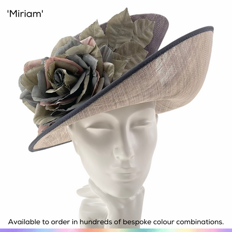 Miriam.  A mid-brim ladies occasionwear hat featuring a dramtic upturned sweeping brim and angular crown.  The hat has been trimmed with a classic English Tea rose made using different shades of silk.  Available to order in thousands of colour combinations to match your outfit perfectly.  Handmade by Marvellous Millinery, Winchester, Hampshire UK.  Bespoke ladies wedding hats for Mother of the Bride, Mother of the Groom, Top Table Wedding Guests, Ladies Day at Royal Ascot, Glorious Goodwood, Garden Parties at Buckingham Palace and Royal Investitures.