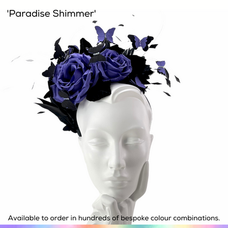 Paradise Shimmer.  A ladies halo style headband fascinator featuring a pair of graduated handmade silk roses, a spray of feathers, bobbing trimmed quills and silk butterflies set with crystals.  Available to order in thousands of colour combinations to match your outfit perfectly.  Handmade by Marvellous Millinery, Winchester, Hampshire UK.  Bespoke ladies wedding hats for Mother of the Bride, Mother of the Groom, Top Table Wedding Guests, Ladies Day at Royal Ascot, Glorious Goodwood, Garden Parties at Buckingham Palace and Royal Investitures.