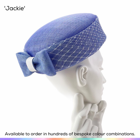 Jackie.  A classic pillbox hat made famous in the 60s and shown here with a swathe of birdcage veiling around the crown and a petite bow to the rear.  Available to order in thousands of colour combinations to match your outfit perfectly.  Handmade by Marvellous Millinery, Winchester, Hampshire UK.  Bespoke ladies wedding hats for Mother of the Bride, Mother of the Groom, Top Table Wedding Guests, Ladies Day at Royal Ascot, Glorious Goodwood, Garden Parties at Buckingham Palace and Royal Investitures.