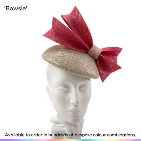 Bowsie.  A dramatic angular double bow sitting at a jaunty angle above a classic beret style perching pillbox hat.  Available to order in thousands of colour combinations to match your outfit perfectly.  Handmade by Marvellous Millinery, Winchester, Hampshire UK.  Bespoke ladies wedding hats for Mother of the Bride, Mother of the Groom, Top Table Wedding Guests, Ladies Day at Royal Ascot, Glorious Goodwood, Garden Parties at Buckingham Palace and Royal Investitures.