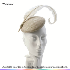 Marian.  A modern style perching pillbox hat in the style of a petite button, and simply trimmed with a single hand-curled feather that adds hight and volume.  Available to order in thousands of colour combinations to match your outfit perfectly.  Handmade by Marvellous Millinery, Winchester, Hampshire UK.  Bespoke ladies wedding hats for Mother of the Bride, Mother of the Groom, Top Table Wedding Guests, Ladies Day at Royal Ascot, Glorious Goodwood, Garden Parties at Buckingham Palace and Royal Investitures.