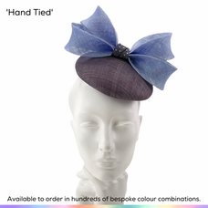 Hand Tied.  A petite perching button pillbox hat featuring a sculpted double bow in a contrast colour.  The cynch has been decorated with a scattering of complimentary crystals.  Available to order in thousands of colour combinations to match your outfit perfectly.  Handmade by Marvellous Millinery, Winchester, Hampshire UK.  Bespoke ladies wedding hats for Mother of the Bride, Mother of the Groom, Top Table Wedding Guests, Ladies Day at Royal Ascot, Glorious Goodwood, Garden Parties at Buckingham Palace and Royal Investitures.