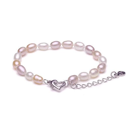 Perles d'eau douce blanches, roses et violettes