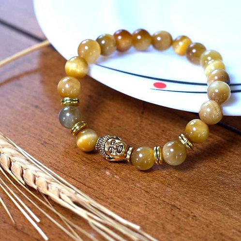 Oeil de tigre jaune et tête de Bouddha dorée