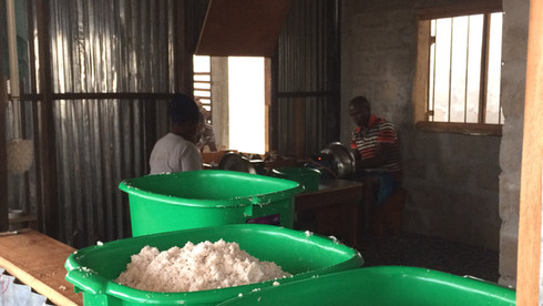 Weighing grated coconut