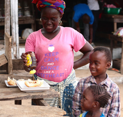 People enjoying Liberia Pure Honey