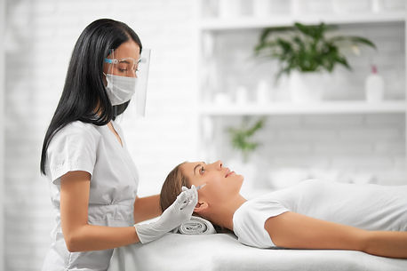 side-view-brunette-beautician-protective-mask-doing-beauty-injection-improvements-skin-fac