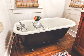 Clawfoot Tub Asheville interior designer Jordan Chatham, The Chatham Collection, Timeless Vintage Finds and Interior Design