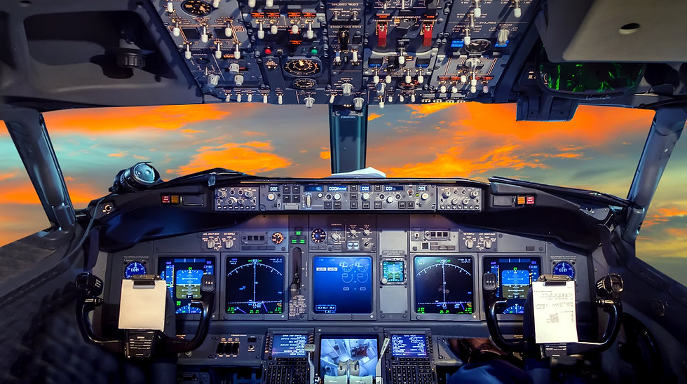 airplane cockpit Flight Deck in sunset.j