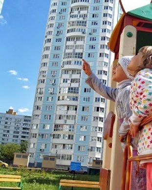 Small girls looking over apartment tower