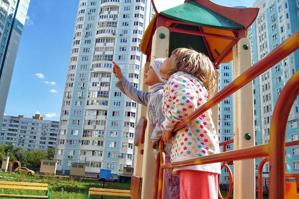Small-girls-looking-over-apartment-tower