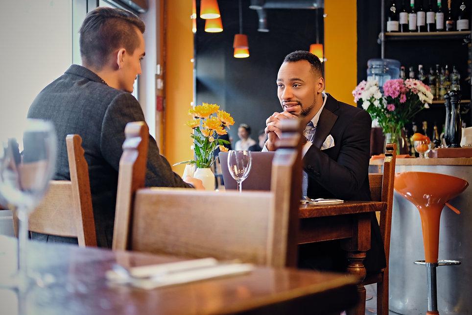 men-having-a-business-meeting-in-a-resta