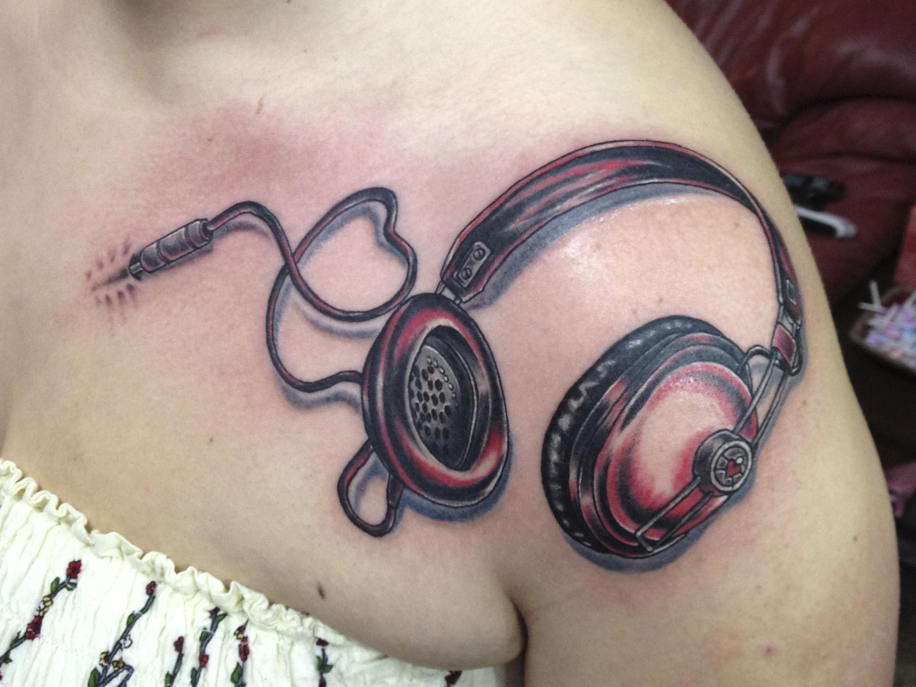 headphones on shoulder