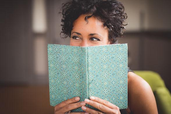 Akwi Nji with book