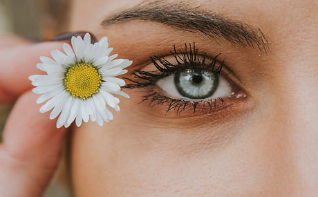 white petaled flower near woman eye_edited_edited.jpg