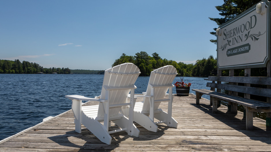 Main Dock white chairs with sherwood sig