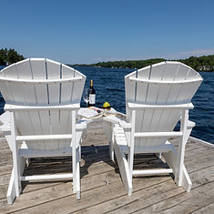 Main Dock white chairs wine book glasses.jpg
