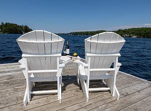 Main Dock white chairs wine book glasses