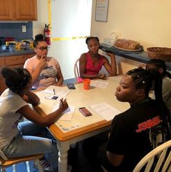 Scholars discuss community challenges .jpg